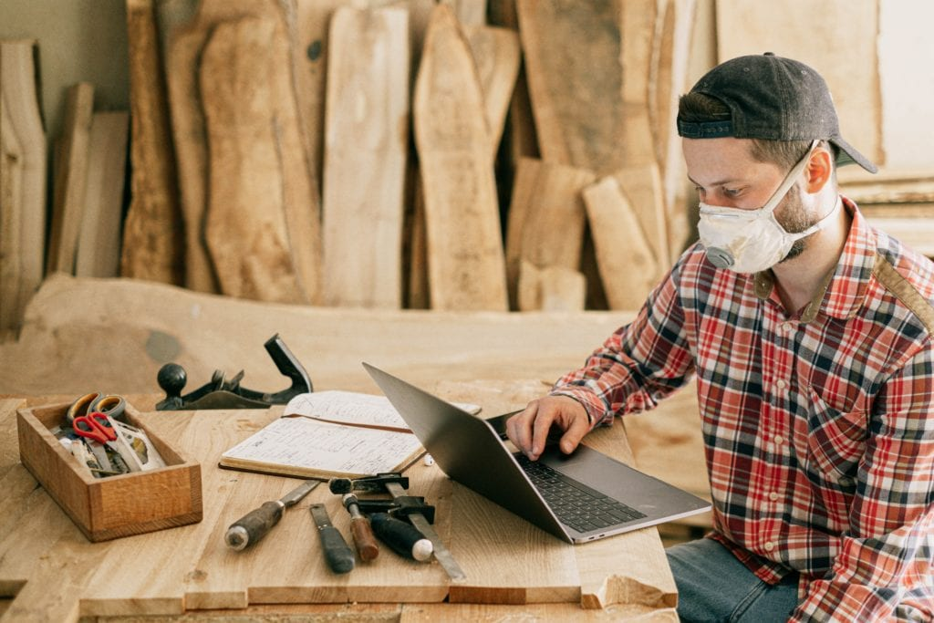 construction professional uses laptop to analyze construction work